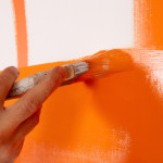 a painter makes orange wall